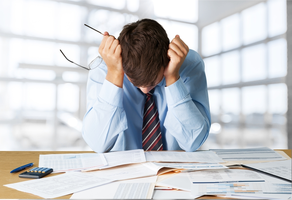 Picture of a frustrated man filing for bankruptcy.