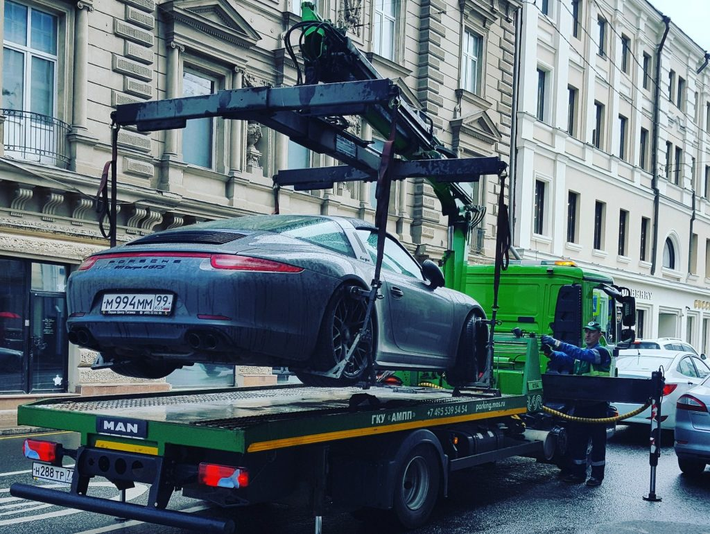 Picture of a car getting towed.