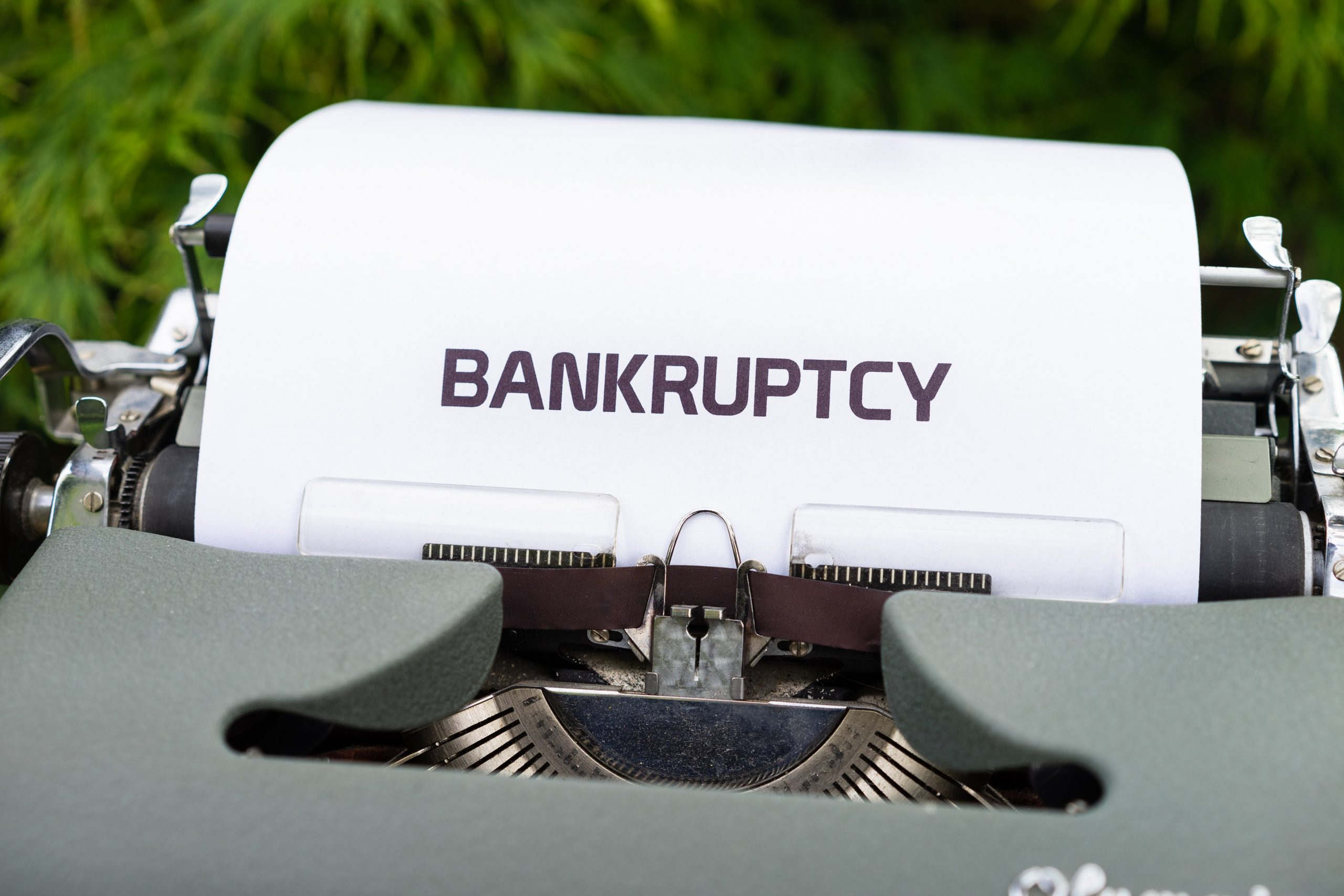 """Typewriter with a piece of paper that says, """"Bankruptcy."""""""